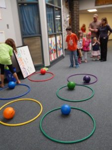 Kids' Club members and friends played a game where a ball was tossed into the hula hoops.