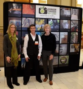 Hunger Through My Lens participants in front of the statewide exhibit